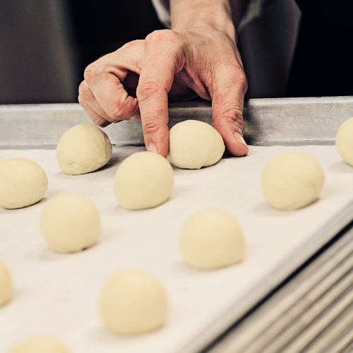 close-up-of-hand-of-baker-making-dough-AEY93N7